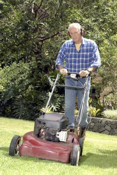 Man Mowing yard with ear protection